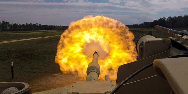 File photo - Troopers with the U.S. Army 2nd Armored Brigade Combat Team, 3rd Infantry Division, firing the main gun round at a target during unit gunnery practice with newly acquired M1A1-SA Abrams tanks at Fort Stewart, Georgia, in March 2018.