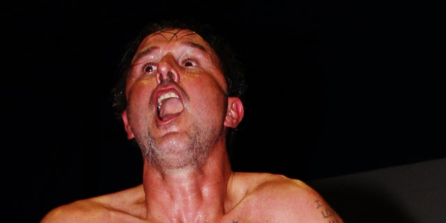 David Arquette battles opponent, Brian Anthony of Northeast Wrestling, in the ring.