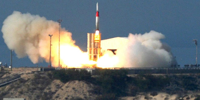 This file photo, taken on Friday Dec. 2, 2005, released  by Israel Aircraft Industries Ltd., shows an Arrow missile being launched at an undisclosed location in Israel. Israel and the U.S. conducted a joint missile test over the Mediterranean on Tuesday, Sept. 3, 2013, an apparent display of military prowess as the Obama administration seeks congressional support for strikes against the regime of Syrian President Bashar Assad.  A Sparrow missile was launched successfully at 9:15 a.m. and followed its planned trajectory. The Arrow missile defense system successful detected and tracked the target, the ministry said.