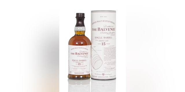 Bottle and tube of a single malt whisky from the highlands: distilled by the distillery Balvenie in Scotland, United kingdom. The whisky is a single barrel filling from an sherry cask and is 15 years old