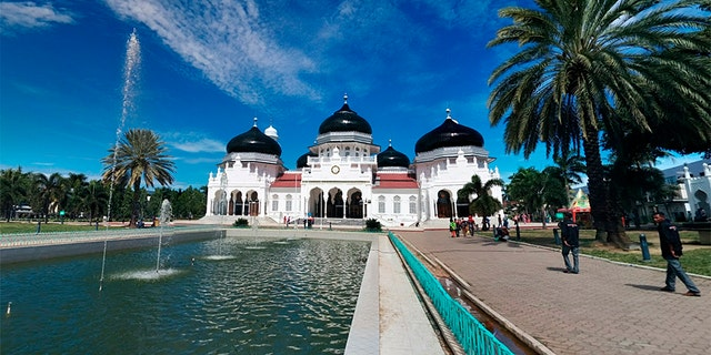 Pictured is the Banda Aceh Grand Mosque where two Christians were flogged under sharia law, accused of gambling.