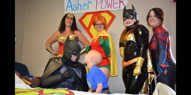 Asher Thrift smiled from ear-to-ear on when Batman, Robin, Batgirl, Wonder Woman, and Spiderman all came into his room.