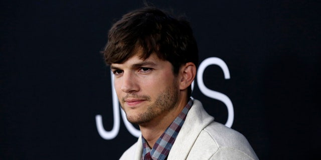 Ashton Kutcher handled a protester at a Airbnb in Los Angeles.