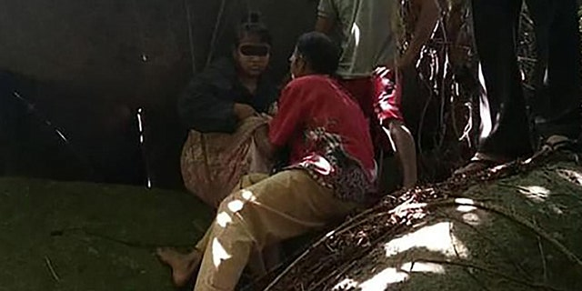 The woman, identified only as HS, was rescued by Indonesian police.