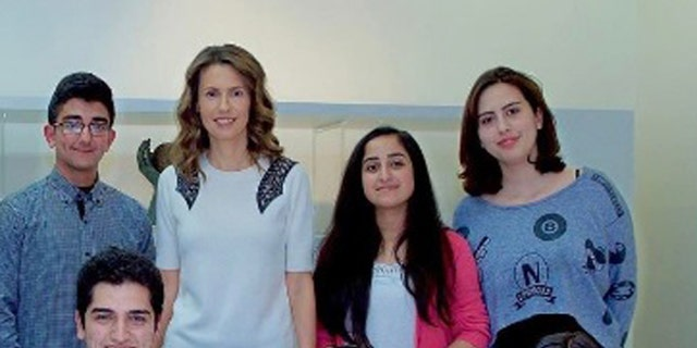 """On April 12, this photo appeared on Asma's Instagram account, showing the first lady meeting with """"the top three students from each class"""" in Damascus."""