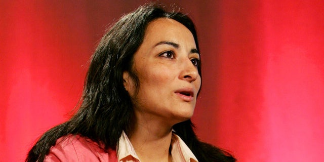 """American Muslim journalist and single mother Asra Nomani during an interview with Reuters in New York, April 6, 2005. Nomani, whose first book was about tantric sex, and is used to being told she is a """"criminal"""" by those of her faith who say they know best, is determined to fight back saying """"we have to rewrite modern day history so that Islam can turn a page and join the rest of the world with social justice and equity as our greatest defining factors not fear and persecution and repression."""" REUTERS/Mike Segar/FEATURE/RELIGION-ISLAM-WOMAN  MS - RTR7CE2"""