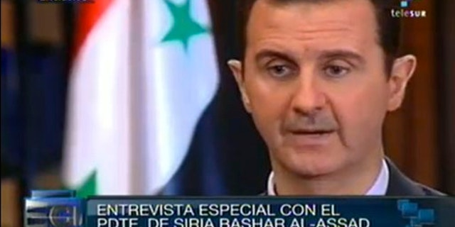 Sept. 25, 2013: In this frame grab taken from online video broadcast on Telesur television, Syria's President Bashar Assad speaks during an interview with a Telesur reporter in Damascus, Syria.