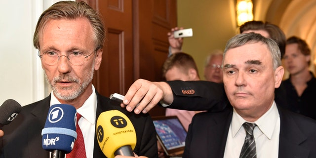 July 16, 2014: Julian Assange's lawyers Tomas Olsson, left, and Per E. Samuelsson talk to media prior to a public court hearing in Stockholm.