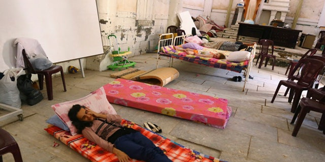 July 20, 2014: An Iraqi Christian family fleeing the violence in the Iraqi city of Mosul, sleeps inside the Sacred Heart of Jesus Chaldean Church in Telkaif near Mosul, in the province of Nineveh.