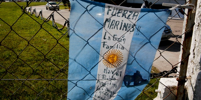 "An Argentine flag reading in Spanish ""Come on marines, the great naval family and the Argentines are with you and pray for you"" hangs from the fence at the naval base in Mar del Plata, Argentina, Sunday, Nov. 19, 2017"