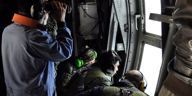 In this Tuesday, Nov. 21, 2017 photo released by the Argentine Navy on Nov. 22, members of the Argentine Air Force search for a missing submarine in the South Atlantic near Argentina's coast.