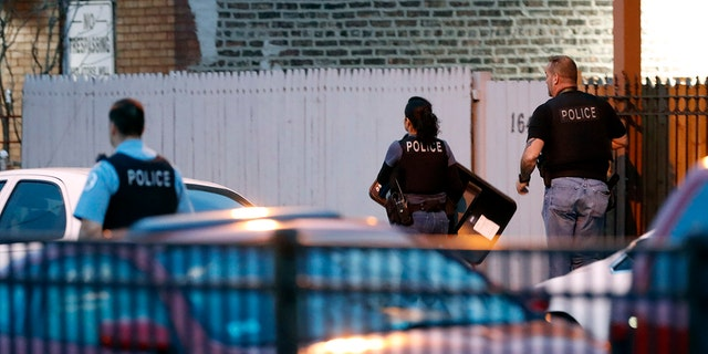 Chicago police work the scene near the area where a federal agent was shot and critically wounded in Chicago while working on an investigation with local authorities on Friday, May 4, 2018.