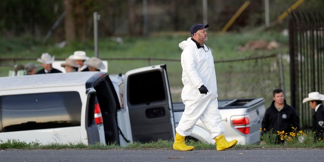 Officials investigate the scene where a suspect in a series of bombing attacks in Austin blew himself up as authorities closed in, Wednesday, March 21, 2018, in Round Rock, Texas