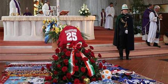 The coffin of Livorno's soccer player Piermario Morosini is seen during his funeral in Bergamo April 19, 2012. REUTERS/ANSA/Pool
