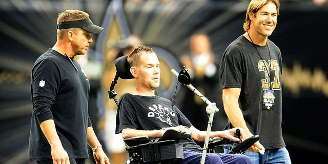 NEW ORLEANS, LA - SEPTEMBER 08: ( L to R ) Sean Payton, head coach of the New Orleans Saints, takes the field with former players Steve Gleason and Scott Fujita prior to a game against the Atlanta Falcons at the Mercedes-Benz Superdome on September 8, 2013 in New Orleans, Louisiana. The Saints defeated the Atlanta Falcons 23-17. (Photo by Stacy Revere/Getty Images)