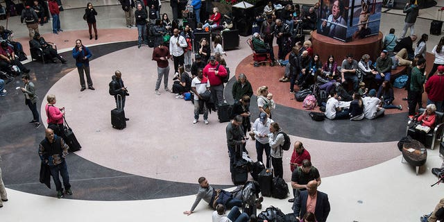 Travelers were stuck at the Hartsfield-Jackson airport after a power outage grounded more than 1,000 flights on Sunday.