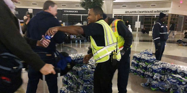 Water and food were distributed to affected passengers after vending machines and food vendors were unable to operate as usual.