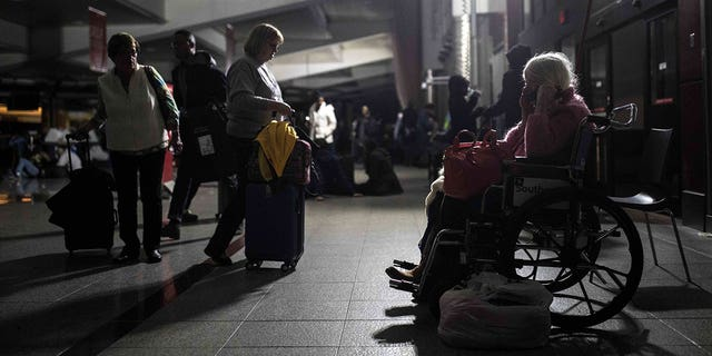Some passengers said wheelchair-bound passengers were especially 'helpless,' and that airport staff had to carry them up and down stairs.