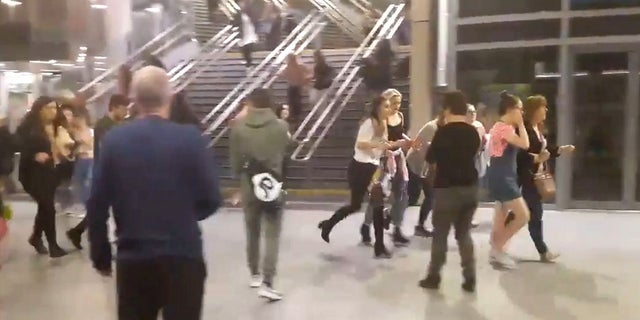 This image shows people running through Manchester Victoria station after an explosion at Manchester Arena on May 22, 2017.