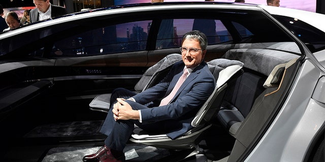 Audi CEO Rupert Stadler sits in an Audi Aicon show car during an event of German car maker Volkswagen on the eve of the opening of the International Frankfurt Motor Show IAA in Frankfurt, Germany, Monday, Sept. 11, 2017, which runs through Sept. 24, 2017. (AP Photo/Martin Meissner)