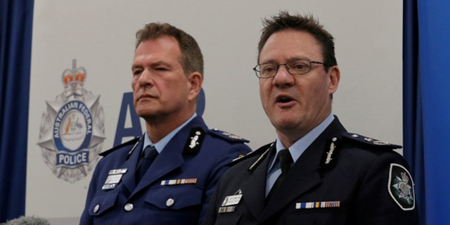 Australian Federal Police Deputy Commissioner Michael Phelan, right, and New South Wales Police Deputy Commissioner David Hudson address reporters in Sydney, Aug. 4, 2017.