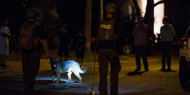 A bomb detecting unit walks along a street near the scene of an explosion on March 18.