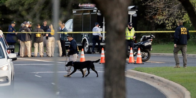Officials work and stage near the site of Sunday's explosion on March 19, 2018, in Austin, Texas.