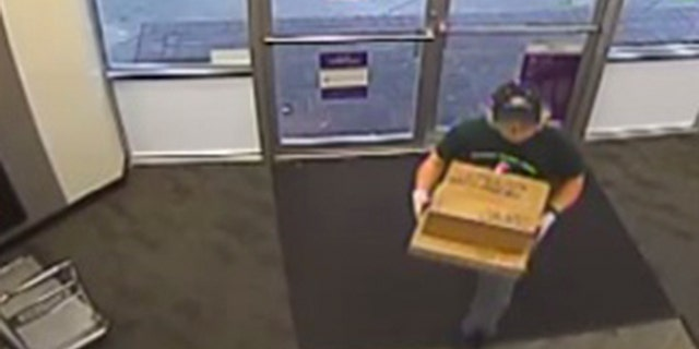 Surveillance photos show Mark Anthony Conditt dropping off two suspicious packages on Sunday from inside a South Austin FedEx Office store, where authorities said he shipped the two items with explosive devices inside.