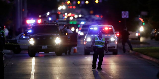 Emergency vehicles stage near the site of another explosion, Tuesday, March 20, 2018, in Austin, Texas.