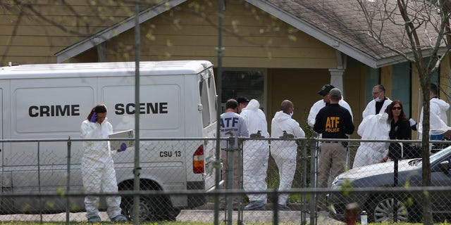 Law enforcement personnel investigate the home where Austin serial bomber Mark Anthony Conditt lived in Pflugerville, Texas.