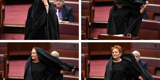 In this combination of photos, Sen. Pauline Hanson takes off a burqa she wore into the Senate chamber at Parliament House in Canberra.