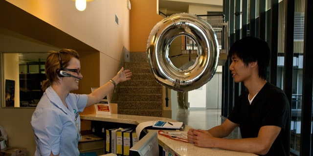 Bryan Huangs doughnut blimp helps guide visitors from reception to meeting rooms.