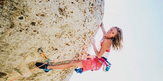 In this undated photo provided by Louis Arevalo, Inge Perkins climbs Cowboy King (5.13c) in Wild Iris, Wyo. Gallatin County sheriff's officials say Perkins was skiing with her boyfriend Hayden Kennedy on Imp Peak on Saturday, Oct. 7, 2017, when they triggered an avalanche in a steep, narrow gulley. Perkins, was buried by the 150-foot-wide slide. Kennedy, who was partially buried, pulled himself free and hiked out for help after he couldn't find his girlfriend. (Louis Arevalo via AP)