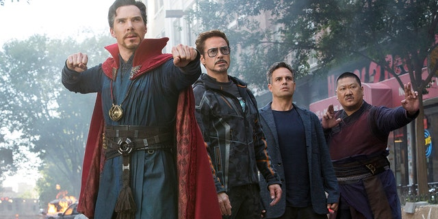 "This image released by Marvel Studios shows, from left, Benedict Cumberbatch, Robert Downey Jr., Mark Ruffalo and Benedict Wong in a scene from ""Avengers: Infinity War."""
