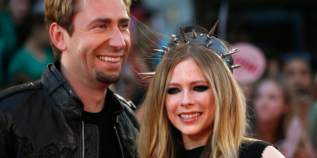 Singers Avril Lavigne and Chad Kroeger arrive on the red carpet for the MuchMusic Video Awards (MMVAs) in Toronto, June 16, 2013.