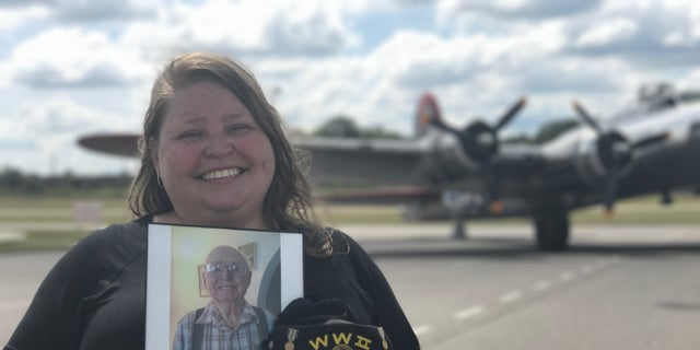Erin Creed holds a photo of her Grandfather Dan Creed who fought in Europe during WWII. Columbia, S.C.