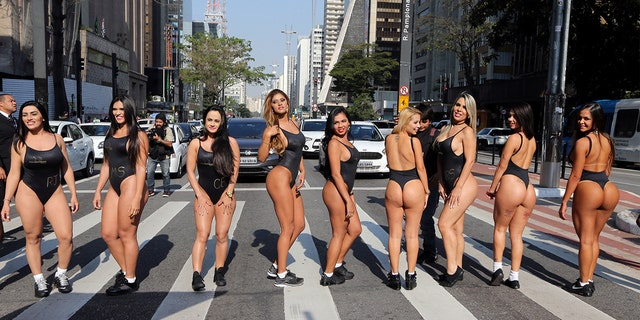 Miss BumBum Brazil 2017 pageant contestants parade at Paulista Avenue in Sao Paulo's financial center.