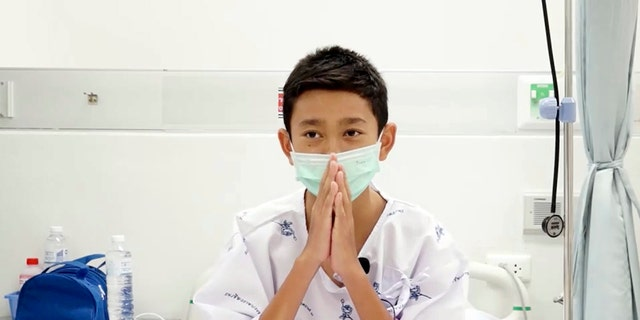 Nattavut Takhamsai, one of the 12 boys rescued from the flooded cave, in their hospital room at Chiang Rai Prachanukroh Hospital in northern Thailand.