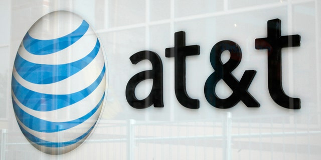 File photo: A view shows the AT&T store sign in Broomfield, Colorado April 20, 2011. (REUTERS/Rick Wilking)