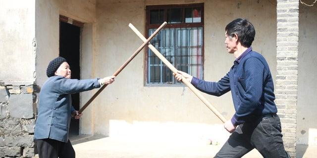 Zhang Hexian, left, practicing Kung Fu.