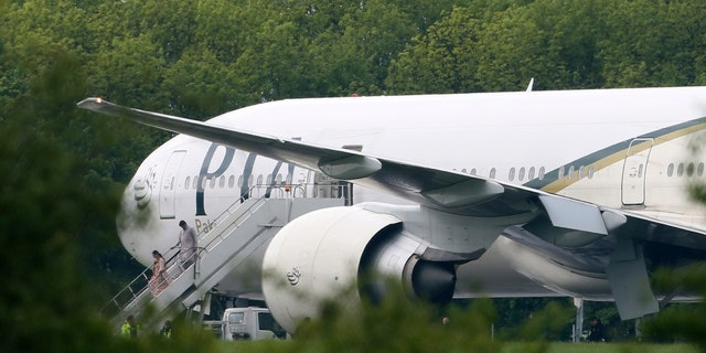 May 24, 2013 - Passengers disembark from Pakistan International Airlines flight PK709 bound for Manchester from Lahore, Pakistan, after it was diverted to Stansted Airport, north of London, England.
