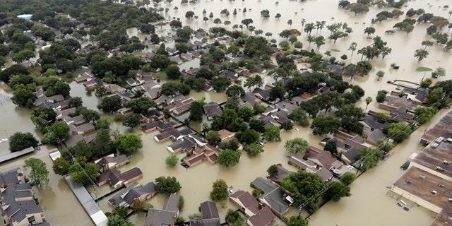 A neighborhood near Addicks Reservoir is flooded by rain from Tropical Storm Harvey.