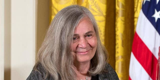 """FILE - In this July 10, 2013, file photo, Marilynne Robinson appears at a ceremony awarding her the 2012 National Humanities Medal for  grace and intelligence in writing in the East Room of White House in Washington. Robinson, the acclaimed author of such novels as """"Gilead"""" and """"Housekeeping,"""" is this year's winner of the Library of Congress Prize for American Fiction, a lifetime achievement honor. (AP Photo/Carolyn Kaster, File)"""