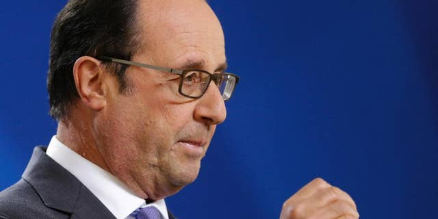 French President Francois Hollande answers a question from the media during the final press briefing at the EU Summit in Brussels, Friday, Oct. 21, 2016. France warned British Prime Minister Theresa May at her maiden European Union summit that she would face a tough, unyielding bloc if she sought too many concessions during the negotiations to leave the 28-nation EU. (AP Photo/Alastair Grant)