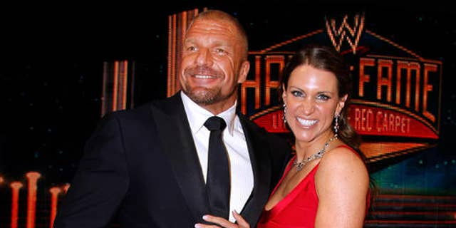 Paul Levesque aka Triple H and Stephanie McMahon are seen at the WWE Hall of Fame Induction at the Smoothie King Center in New Orleans.