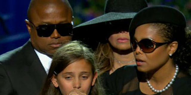 A Young Paris Jackson with her Aunt Janet, emotionally speaks at her father's funeral in 2009.