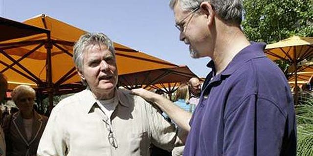 Pastor Jim Garlow from San Diego's evangelical Skyline Church, left, talks with openly gay church member Dean Hughes. (AP)