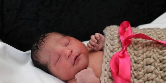This photo provided by the Wichita Police shows Sofia Victoria Gonzalez Abarca, a missing week-old baby in Wichita, Kan.  Police in Kansas say the week-old newborn girl who went missing after her mother was shot to death has been found alive in Dallas. Chief Gordon Ramsay said Saturday, Nov. 19, 2016 that suspects in the death of 27-year-old Laura Abarca-Nogueda took the child and fled to Texas, where Sofia Victoria Gonzalez Abarca was found safe. Ramsay said two people are in custody.   (Wichita Police via AP)