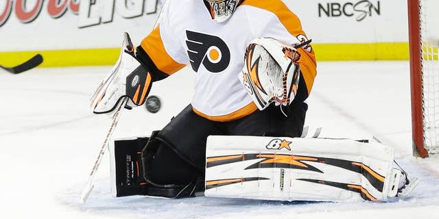 Philadelphia Flyers goalie Ray Emery stops a shot on goal during the second period against the New York Rangers in Game 1 of an NHL hockey first-round playoff series on Thursday, April 17, 2014, in New York. (AP Photo/Frank Franklin II)