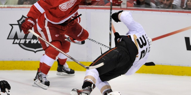 Detroit Red Wings left wing Justin Abdelkader (8) checks Anaheim Ducks defenseman Toni Lydman (32) during the second period in Game 3 of a first-round NHL hockey Stanley Cup playoff series in Detroit, Saturday, May 4, 2013. Abdelkader was ejected for the hit. (AP Photo/Detroit News, John T. Greilick)  DETROIT FREE PRESS OUT; HUFFINGTON POST OUT